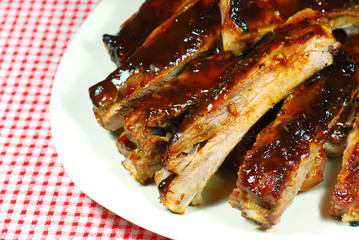 Barbecue Spare Ribs on a plate with a checkered tablecloth