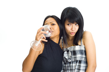 two asian girls with red wine