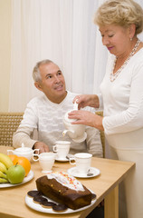 Elderly couple have a breakfast