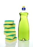 Bottle of green dishwashing liquid and sponges. poster