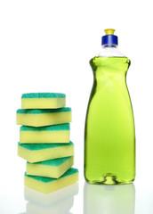 Bottle of green dishwashing liquid and sponges.