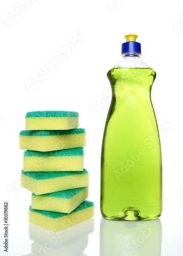 Bottle of green dishwashing liquid and sponges.