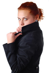 beautiful woman with red hair in a black jacket