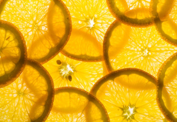 backlit pieces of sliced orange - healthy eating