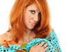 redhead girl in a turquoise knitted cape