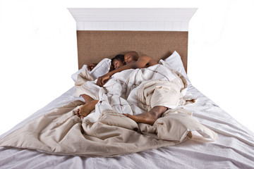 african american couple in bed sleeping