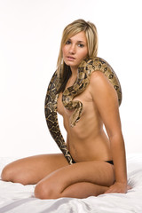 Sexy young blond woman with snake drapped over breast