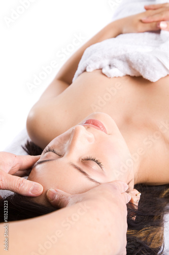 A beautiful asian girl getting massage in a spa salon
