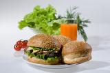 Hamburgers, greenery, tomatoes and juice poster