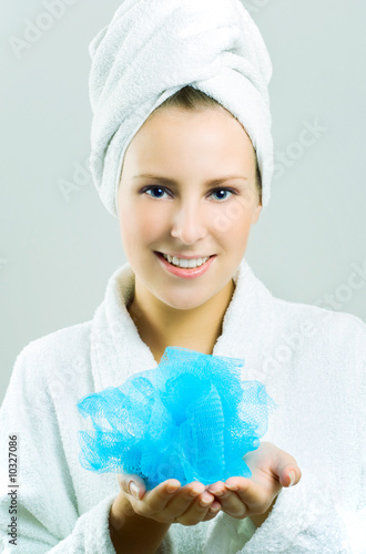 Beautiful girl with bath sponge.