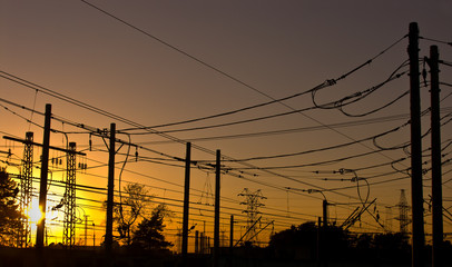 silhouettes of electrical wires on sunset