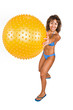 mid aged hispanic woman in swimsuit playing with a gym ball