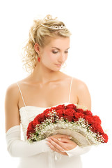 Beautiful bride with a luxury bouquet of red roses