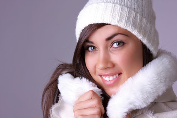 beautiful young woman in coat.
