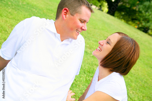happy couple embracing in the park. young family