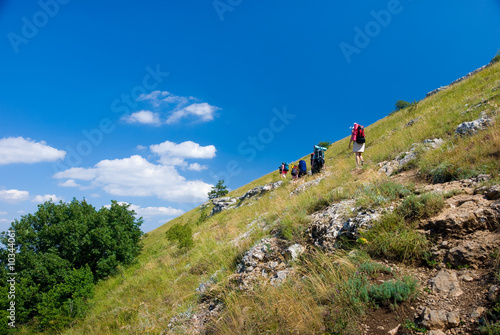 Group of hikers clamber in mountains..