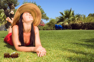 Young beautiful woman enjoying the sun