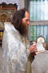 The Russian orthodox priest in a temple