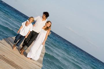 happy family walking on beach vacation