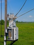 Lowering transformer installed on an electric pole poster