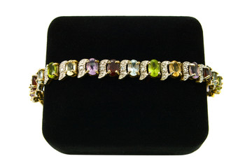 Multi-colored gemstone bracelet on a black velvet box