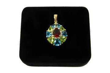 Multi-colored gemstone pendant on a black velvet box