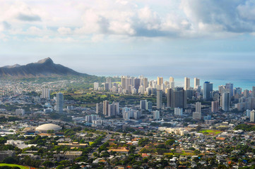 Dramatic view of Honolulu and Diamond Head from high overhead