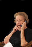 Grandmotherly woman hearing good news on a cell phone poster