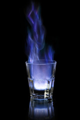 Flaming sambuca over black