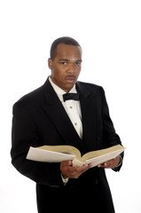 African American minister reading from bible
