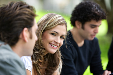 group of friends outdoors in a park smiling