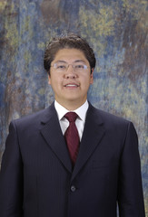 Attractive asian businessman in a suit