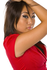 beautiful asian woman red suit hands in hair