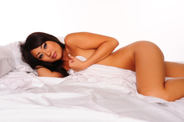 sensuous asian nude woman lying down covering with sheet