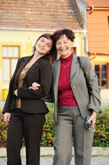 Mature woman has happy time with her daughter on street