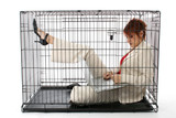 Thirty something business woman trapped in cage. poster