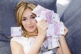 Woman with handful of money, looking pleased with herself poster