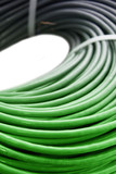 Hank of a black-green network cable on a white background poster