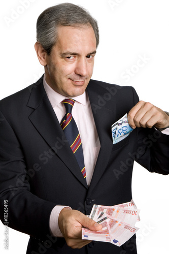 mature business man with money over white background