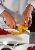 Chef preparing pepper on professional kitchen in restaurant poster