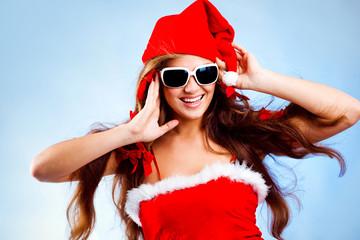 Happy fashion Santa helper with long hair on blue background