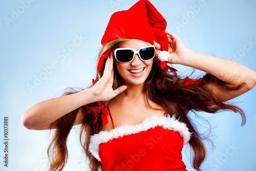 Happy fashion Santa helper with long hair on blue background