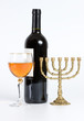 The Jewish menorah, bottle of wine and a glass