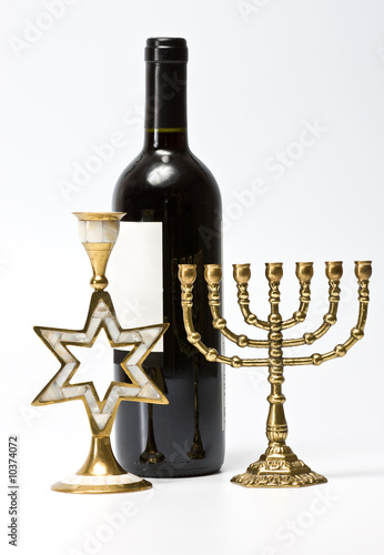 The Jewish menorah, candlestick and bottle of wine