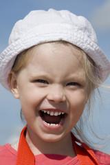 Shouting little girl on the sea coast