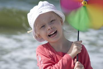 Smiling girl with pinwheel