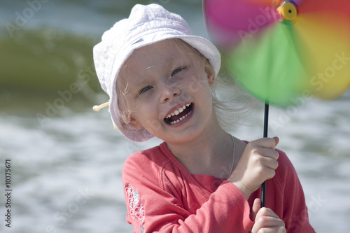 Smiling girl with pinwheel