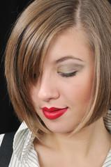 closeup portrait of nice girl on black background
