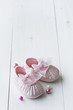 little girls baby shoes on a wooden floor, copy space for text