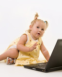 baby girl in pigtails sitting on the floor working on a laptop poster
